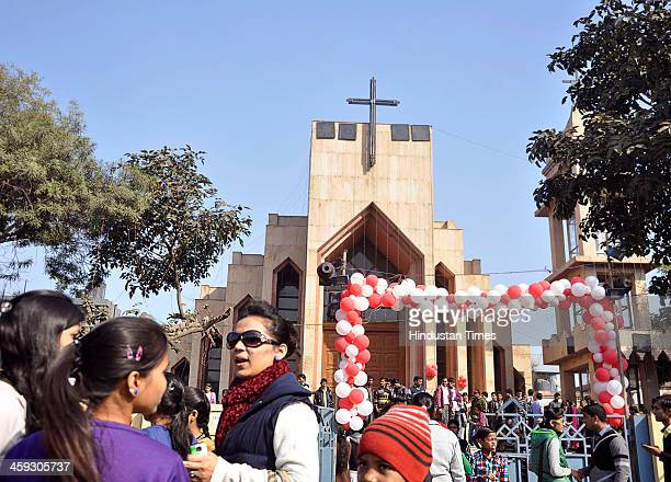 Indian Christians lighting candles at a Christmas Day service outside a Church on December 25 2013 in Ghaziabad India Despite Christians forming a...