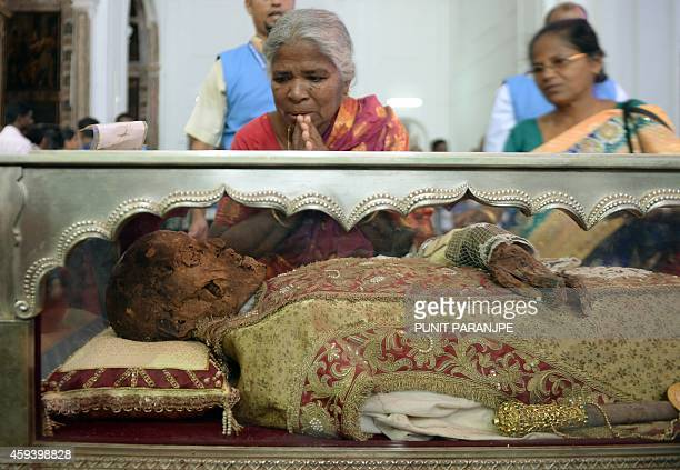 Indian Christians pay their respects to the remains of St Francis Xavier at the Se Cathedral in Goa on November 22 2014 The 17th exposition of the...