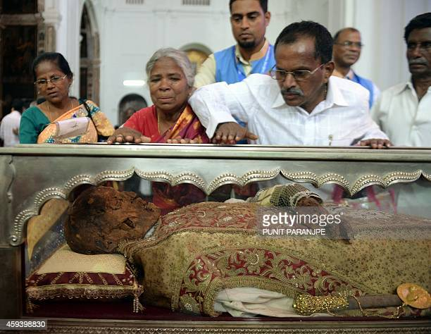 Indian Christians pay their respects to the remains of St Francis Xavier at the Se Cathedral in Goa on November 22, 2014. The 17th exposition of the...