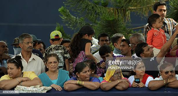 Indian Christians wait for the procession of the remains of St Francis Xavier as it proceeds towards the Se Cathedral in Goa on November 22 2014 The...