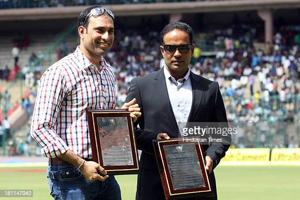 Indian cicketers VVS Laxman and Sunil Joshi pose together during their felicitation ceremony by KSCA during third day of second Test match between...