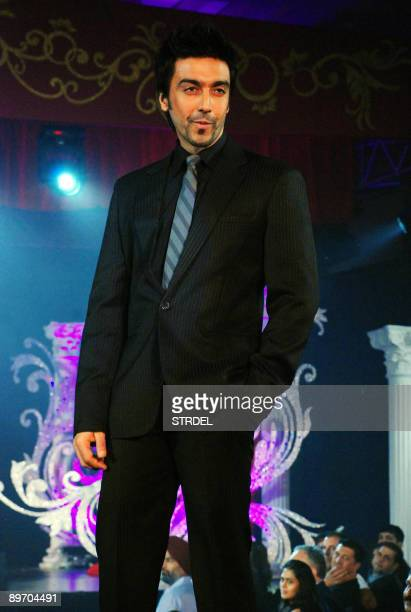 Indian cinema actor Aashish Chaudhary takes part in a fashion show during celebrations for the fifteenth anniversary of Gitanjali Jewellery in Mumbai...