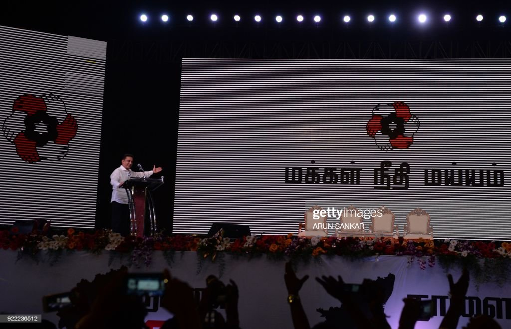 Indian cinema actor Kamal Hassan gestures as he addresses the audience during the launch of his new political party 'Makkal Needhi Mayyam' in Madurai on February 21 ,2018. / AFP PHOTO / Arun SANKAR