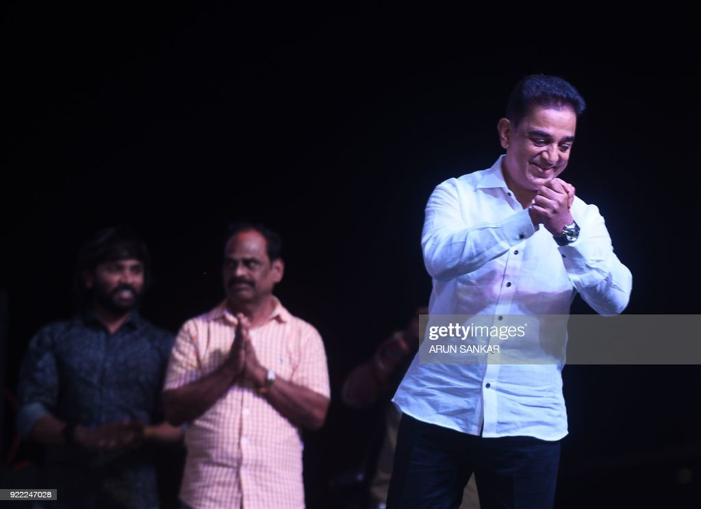 Indian cinema actor Kamal Hassan (R) gestures as he addresses the audience during the launch of his new political party 'Makkal Needhi Mayyam' in Madurai on February 21 ,2018. / AFP PHOTO / Arun SANKAR