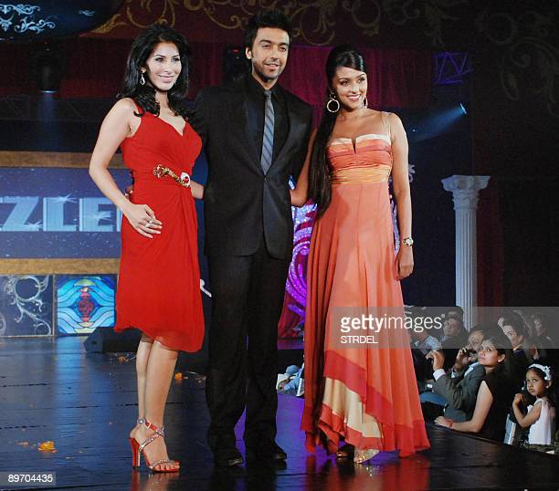Indian cinema actors Sophie Chaudhary Aashish Chaudhary and Aarti Chabria pose as they take part in a fashion show during celebrations for the...