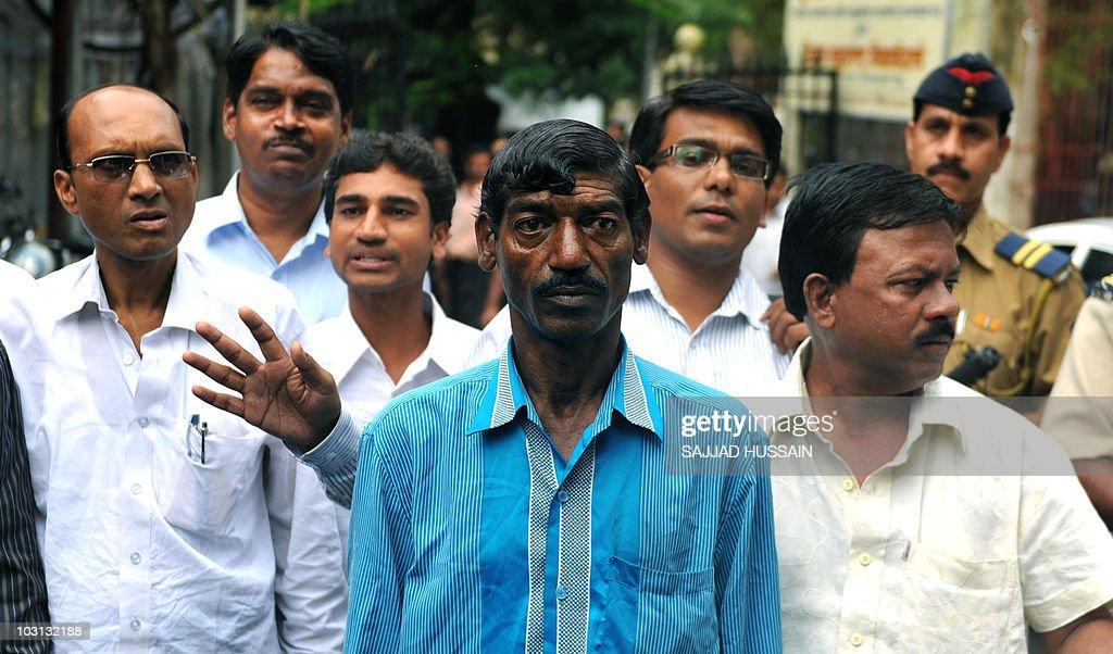 Indian citizen Bhaiyalal Bhotmange (C) a : News Photo