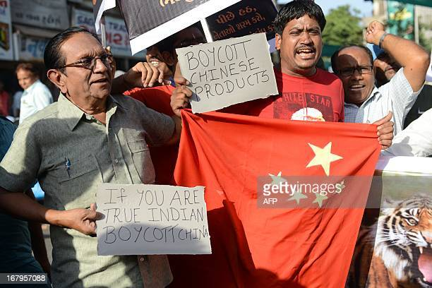 Indian citizens shout antiChinese slogans during a protest to boycott Chinese products in Ahmedabad on May 3 2013 India's prime minister said a...