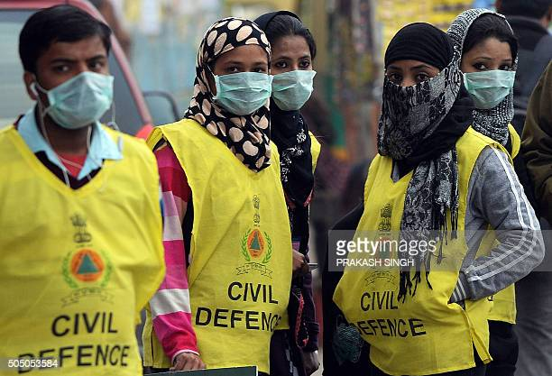 Indian Civil Defence volunteers wear masks as they monitor car licence plate numbers in New Delhi on January 15 2016 New Delhi on January 15 wrapped...