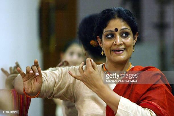 Indian classical dance Bharatnatyam dancer Geeta Chandran gestures as she teaches dance at her school NatyaVriksha in New Delhi 14 July 2006 Dancer...