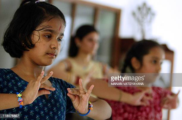 Indian classical dance Bharatnatyam students dance at a school NatyaVriksha in New Delhi 14 July 2006 Dancer Geeta Chandran has been teaching...