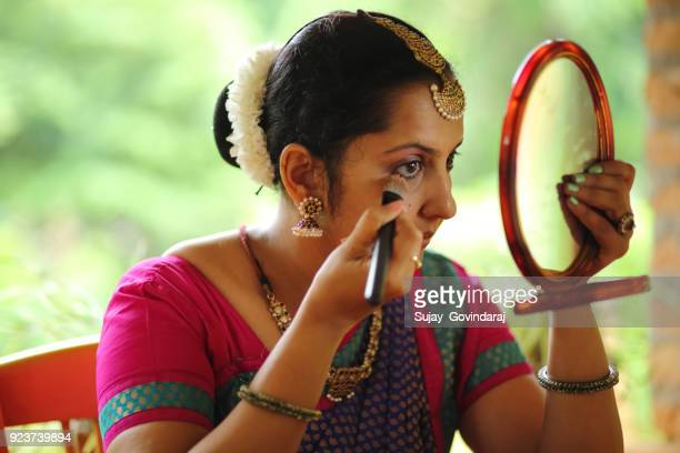 Indian Classical Dancer Applying Make-up
