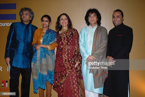 Indian classical musician Taufiq Qureshi with his wife Geetika Varde Qureshi tabla player and composer Zakir Hussain with his wife Antonia Minnecola...