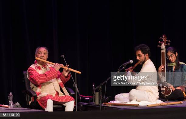 Indian Classical musicians Hariprasad Chaurasia and Jay Gandhi play bansuri with Mashal Awais on tanpura as they perform during a World Music...