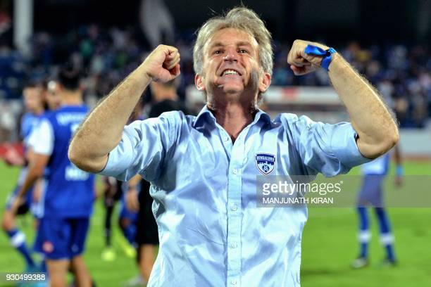 Indian club Bengaluru FC manager Albert Roca Pujol of Spain celebrates after the team's 31 win against Pune City in the Hero ISL semi finals match at...