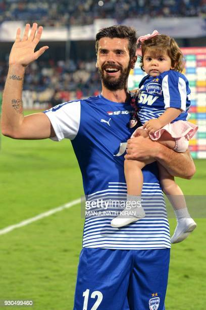 Indian club Bengaluru FC player Spain's Daniel Segovia acknowledges the crowds after the team's 31 win against Pune City in the Hero ISL semi finals...