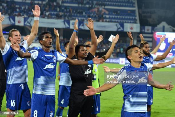 Indian club Bengaluru FC player Sunil Chhetri acknowledges the crowds after the team's 31 win against Pune City in the Hero ISL semi finals match at...