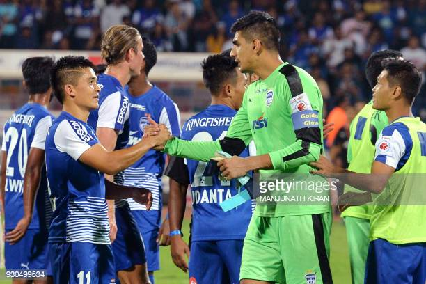 Indian club Bengaluru FC player Sunil Chhetri shakes hands with an opponent after the team's 31 win against Pune City in the Hero ISL semi finals...