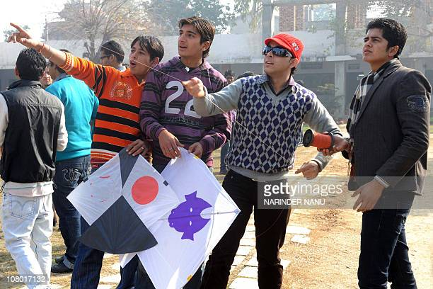 Indian college boys fly kites during celebrations of the festival of Lohri at Shahzada Nand College in Amritsar on January 13 2011 Lohri marks the...