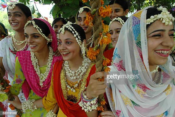 Indian college girls in the traditional Punjabi dress perform 'gidha' during the celebration of the Teej festival on the occasion of Sawan Month at...