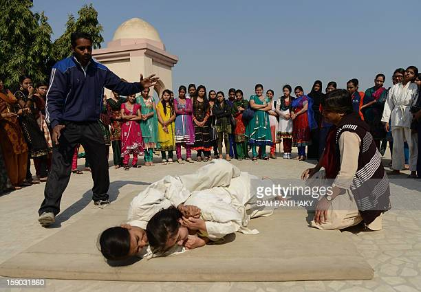 Indian college girls participate in a basic judo camp for self defense in Ahmedabad on January 5 2013 Increasing crime against women and girls with...