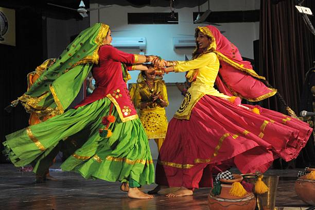 Indian college girls wear traditional Punjabi dress as they perform the Punjabi folk dance the `giddha` during an InterZonal Youth festival...
