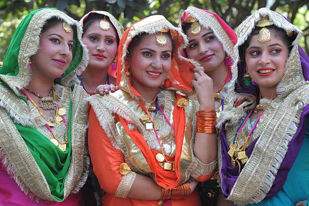 Indian college girls wear traditional Punjabi dress as they wait to perform the Punjabi folk dance the `giddha` during an InterZonal Youth festival...