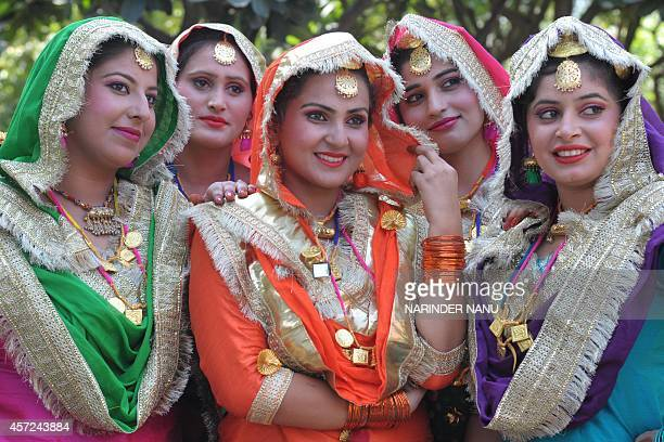 Indian college girls wear traditional Punjabi dress as they wait to perform the Punjabi folk dance the 'giddha' during an InterZonal Youth festival...