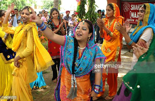 Indian college girls wearing traditional Punjabi dress dance the 'giddha' during Teej festival celebrations at Shahzada Nand College in Amritsar on...