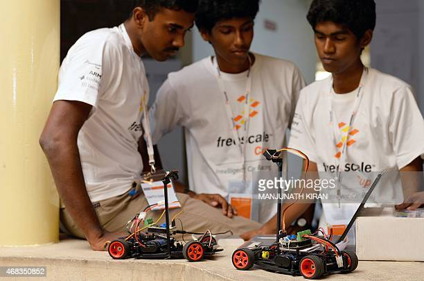 Indian college students programme model cars as they take part in the Freescale Cup 2015 in Bangalore April 2 2015 The event is being held between...