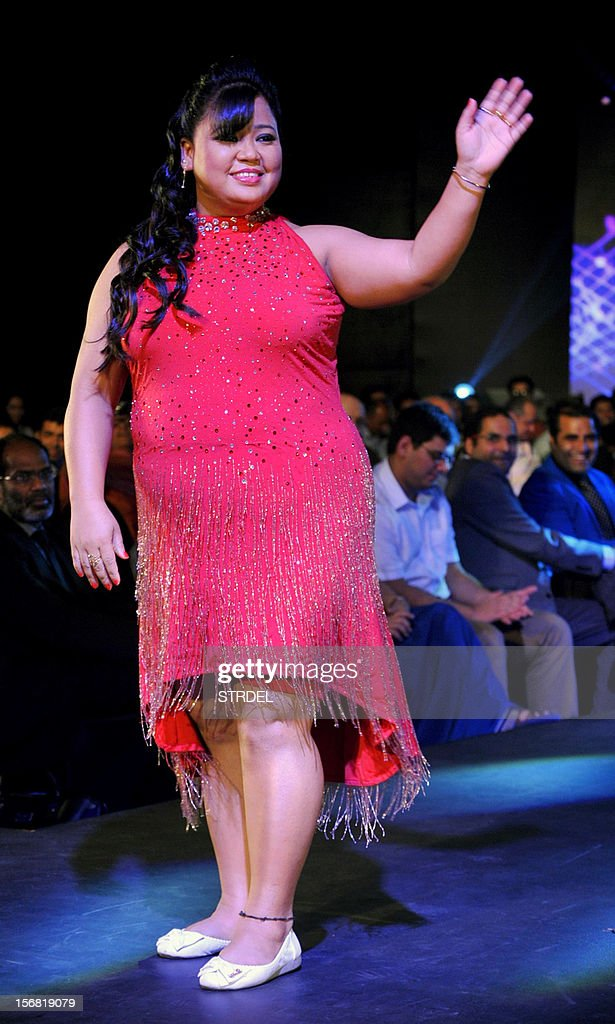 Indian comedian and actress Bharti Singh walks the ramp during a Future Lifestyle Fashion event in Mumbai on November 21, 2012.