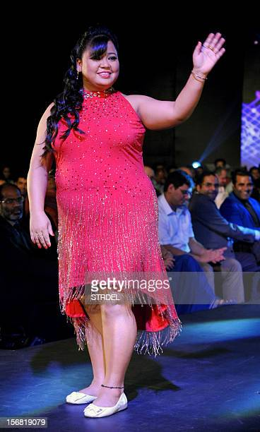 Indian comedian and actress Bharti Singh walks the ramp during a Future Lifestyle Fashion event in Mumbai on November 21 2012 AFP PHOTO/STR