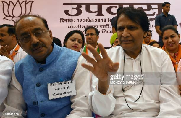 Indian Commerce Minister Suresh Prabhu and Vijay Goel minister of state for parliamentary affairs take part in a fast in New Delhi on April 12 2018...