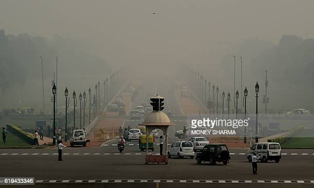 Indian commuters drive through smog in New Delhi on October 31 the day after the Diwali festival New Delhi was shrouded in a thick blanket of toxic...