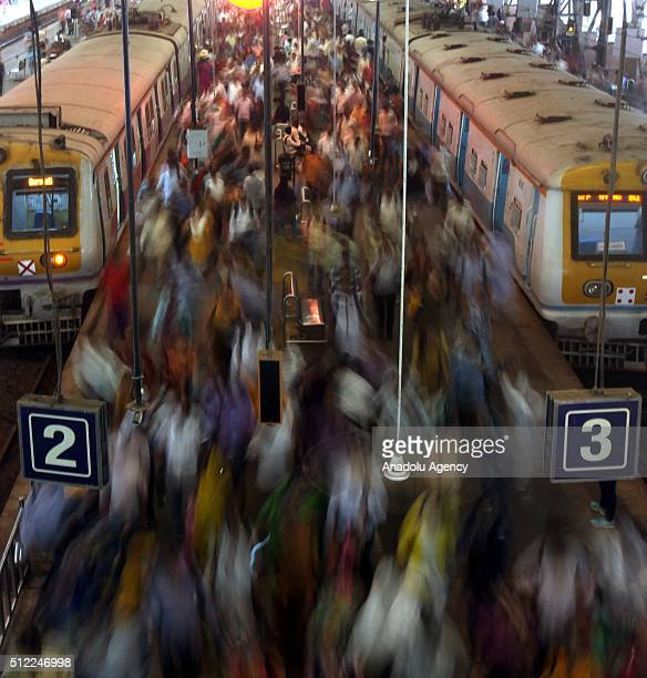 Indian commuters get off from trains at the Church Gate railway station in Mumbai, India on February 25, 2016. Railway Minister Suresh Prabhu...