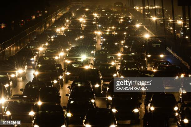 TOPSHOT Indian commuters travel through a traffic jam on their way to New Delhi from Gurgaon on May 3 2016 Hundreds of taxi drivers protested in New...
