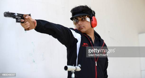 Indian competition shooter Rushiraj Atul Barot aims his pistol during a practise at the Ahmedabad Military and Rifle Training Association/Rifle Club...