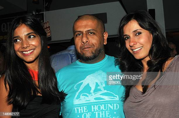Indian composersinger Vishal Dadlani flanked by VJs Juhi Pandey and Ramona pose during a Costa Coffee social event in Mumbai on July 14 2012 AFP...
