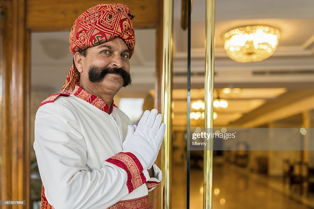 Indian Concierge Welcome Guest at Hotel Entrance India : Stock Photo