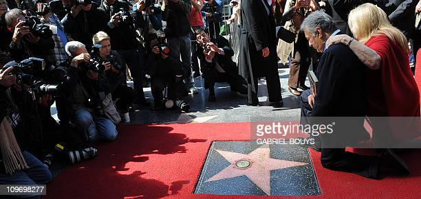 Indian conductor Zubin Mehta poses with his wife Nancy Kovack during the ceremony to unveil his Star on the Walk of Fame in Hollywood California on...
