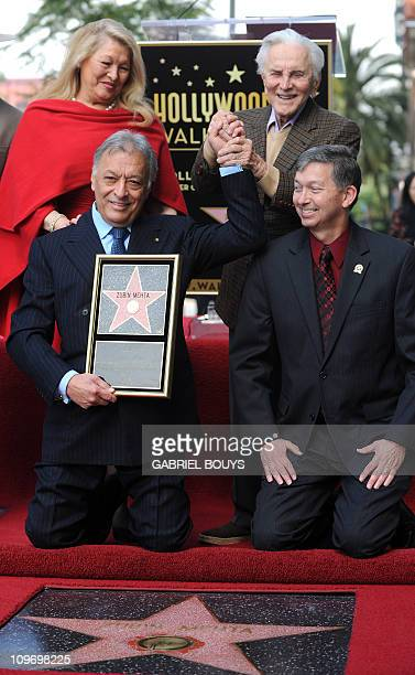 Indian conductor Zubin Mehta poses with Hollywood Chamber of Commerce President/CEO Leron Gubler his wife Nancy Kovack and actor Kirk Douglas during...