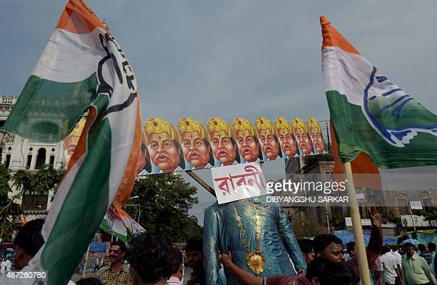 Indian Congress party activists carry an effigy of the Chief Minister of the state of West Bengal Mamata Banerjee showing her as the mythical...