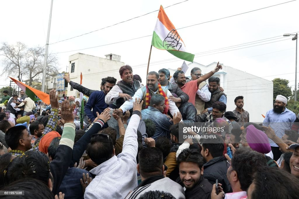 Indian Congress Party candidate for the Jalandhar West constituency Sushil Rinku greets supporters after his win in Jalandhar on March 11 2017 The...