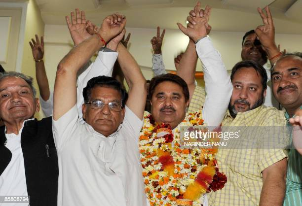 Indian Congress party election candidate and sitting Member of Legislative Assembly OP Soni gestures with former Congress MLA Jasbir Singh Dimpa and...