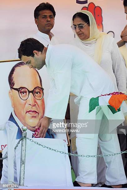 Indian Congress party General Secretary Rahul Gandhi along with Congress senior leader Rajinder Kaur Bhattal places flowers in front of the...
