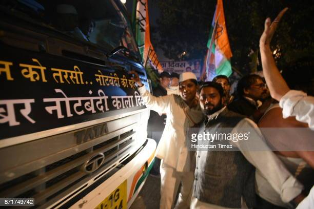 Indian Congress party leader Ghulam Nabi Azad Sharad Yadav and Ajay Maken along with other party workers observed Black Day on the first anniversary...