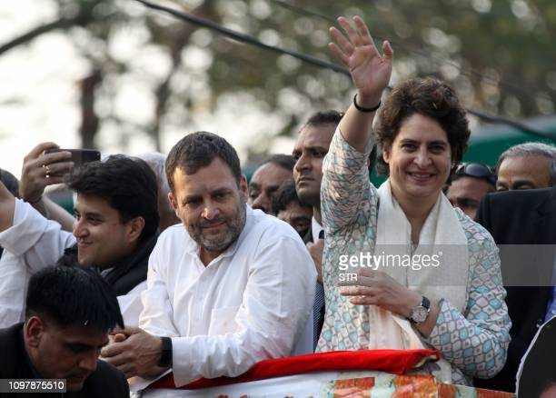 Indian Congress Party leader Rahul Gandhi looks on at a political rally as his sister Priyanka Gandhi Vadra waves to supporters in Lucknow the...