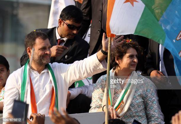 Indian Congress Party leader Rahul Gandhi waves at a political rally next to his sister Priyanka Gandhi Vadra in Lucknow the capital of the election...