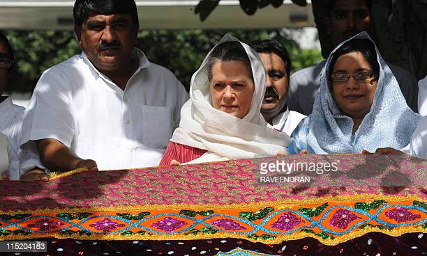 Indian Congress Party President and Chairperson of UPA government Sonia Gandhi poses with a chadar holy shawl at her residence in New Delhi on June 4...