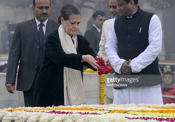 Indian Congress Party President and Chairperson of UPA Government Sonia Gandhi pays homage at Rajghat the memorial of India's founding father Mahatma...