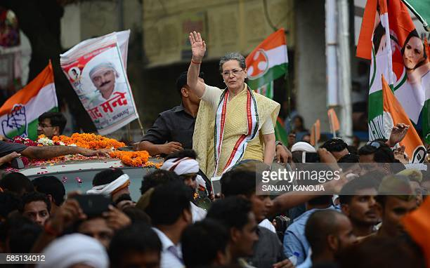 Indian Congress Party President Sonia Gandhi waves during a roadshow in Varanasi on August 2 ahead of 2017 Uttar Pradesh State Assembly elections. /...